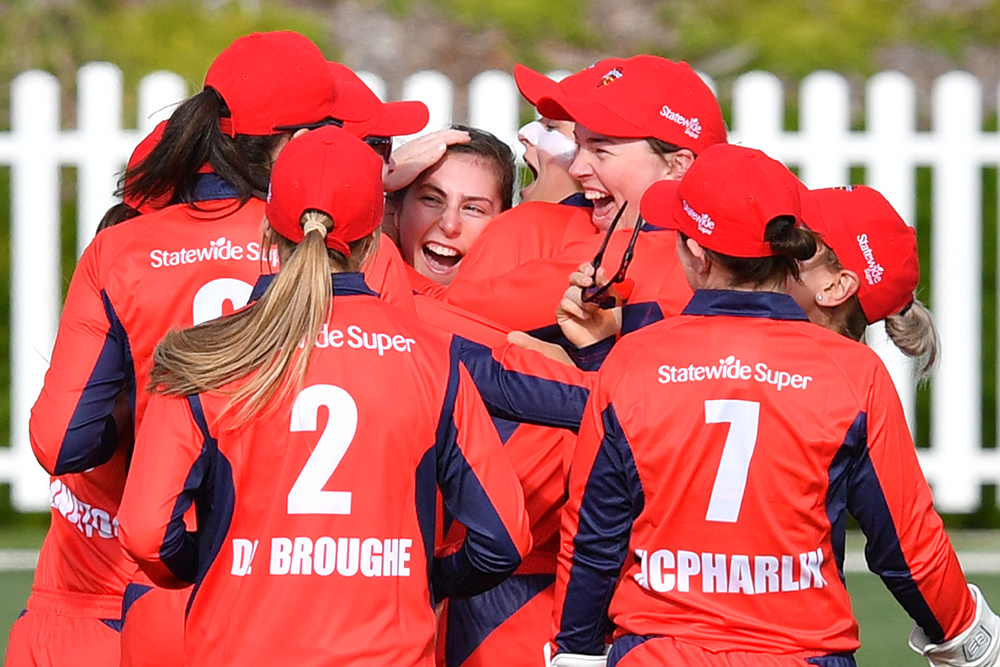 Stacy Oates celebrates a first ball wicket on debut \\ AAP \ David Mariuz