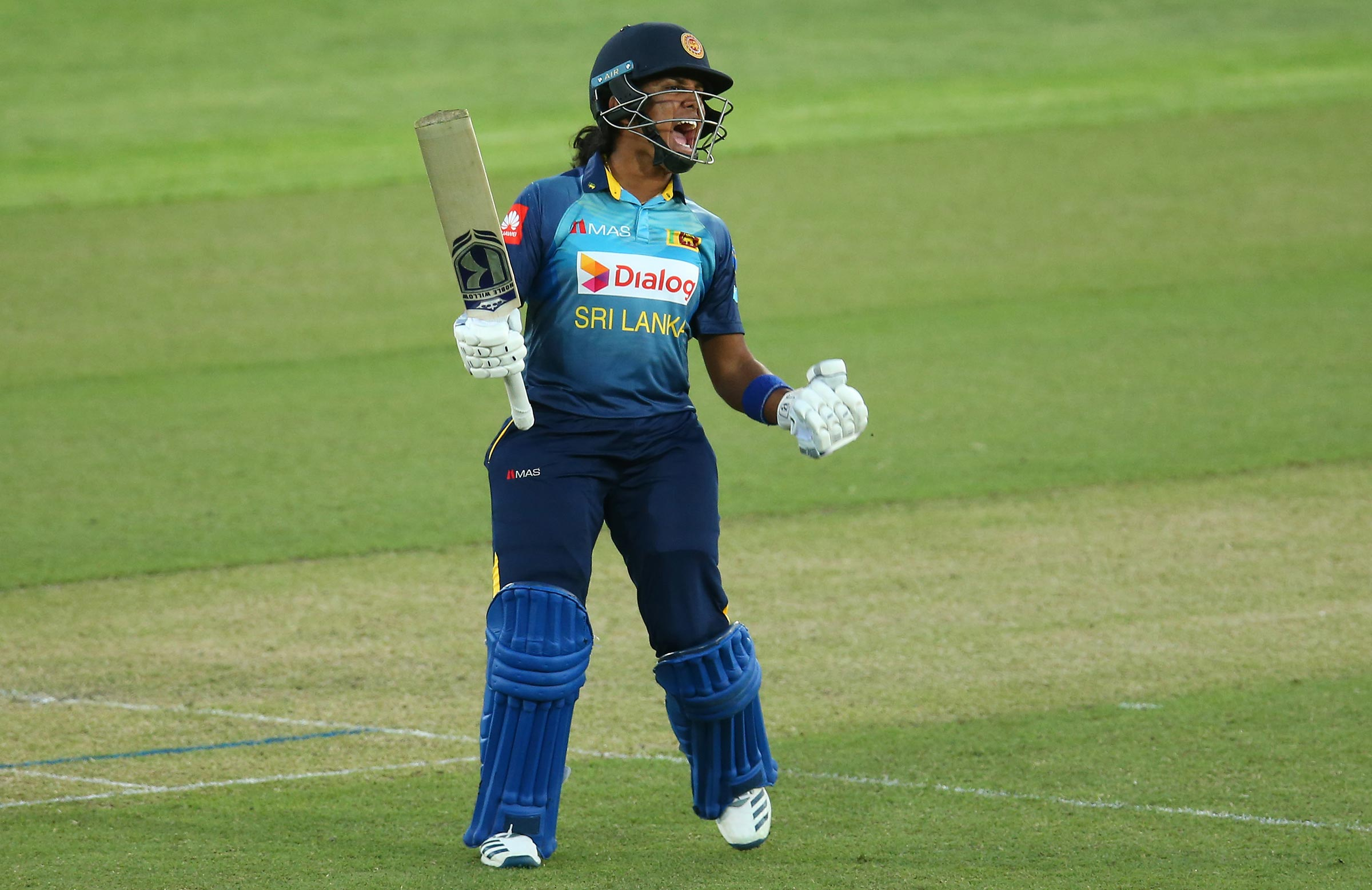 Athapaththu celebrates her T20I century against Australia // Getty