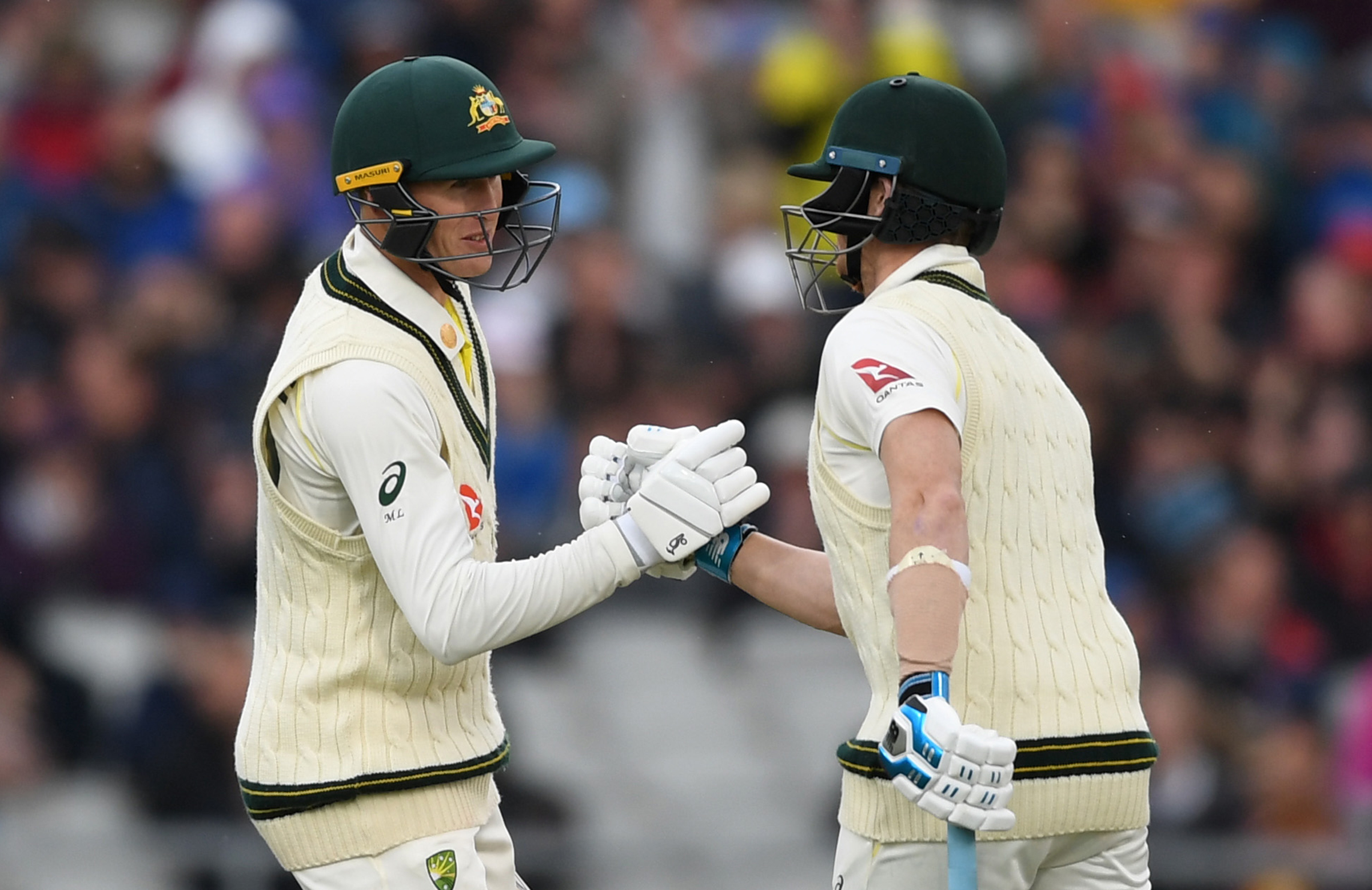 Smith (right) congratulates Labuschagne on his fourth straight fifty // Getty