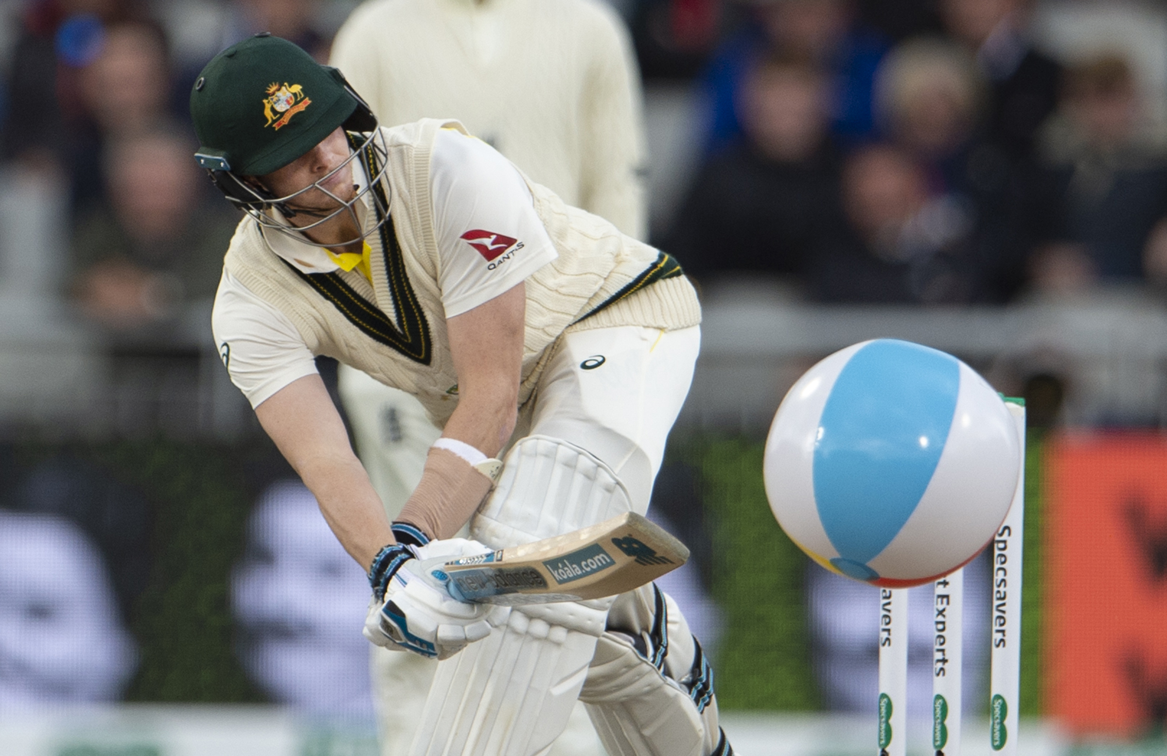 Steve Smith bats away a stray beach ball on day one at Old Trafford // Getty