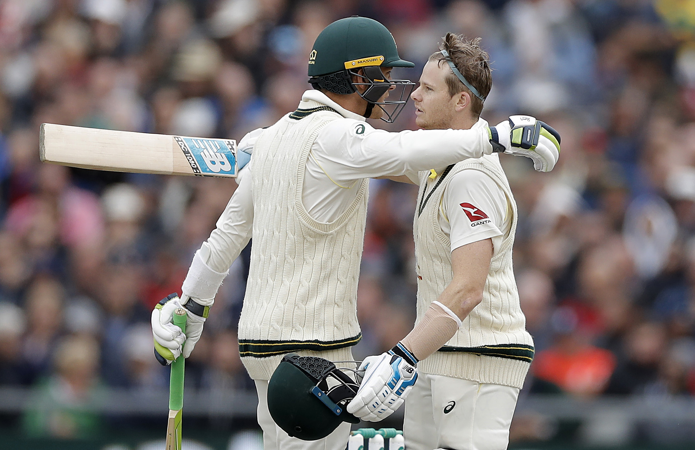 Smith shares an embrace with captain Tim Paine // Getty