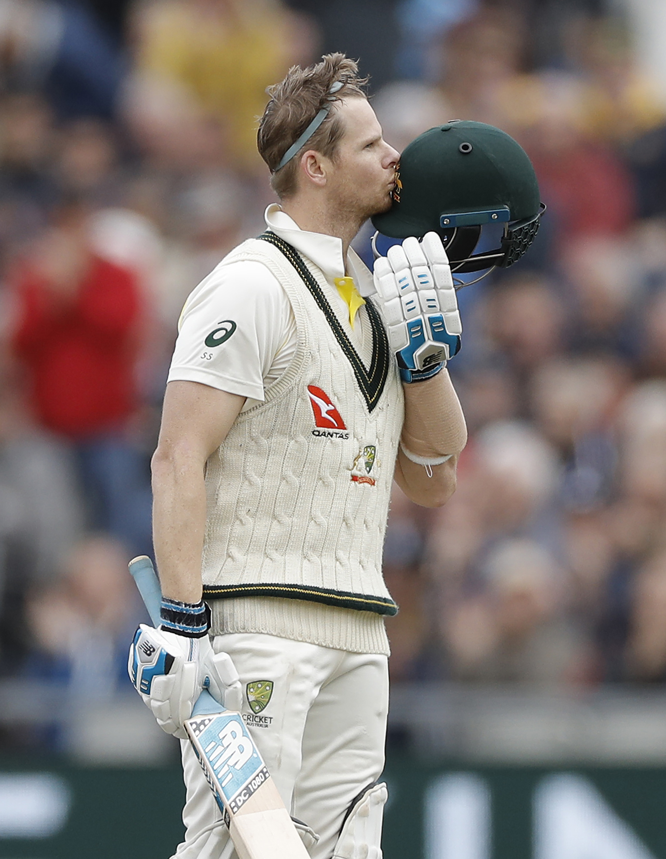 Smith kisses his helmet after reaching his ton // Getty