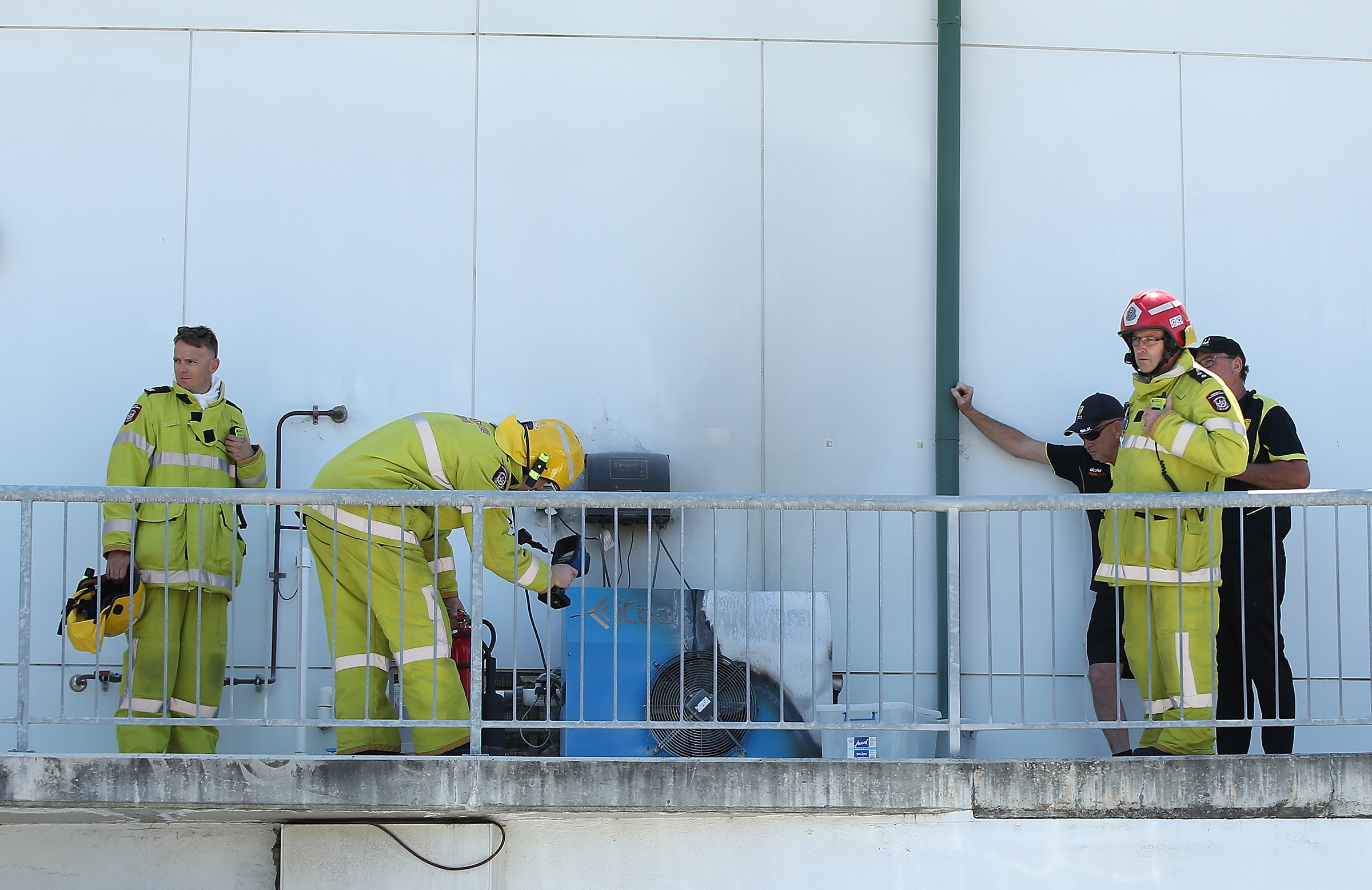 Firemen investigate the guilty air-conditioning unit // Getty