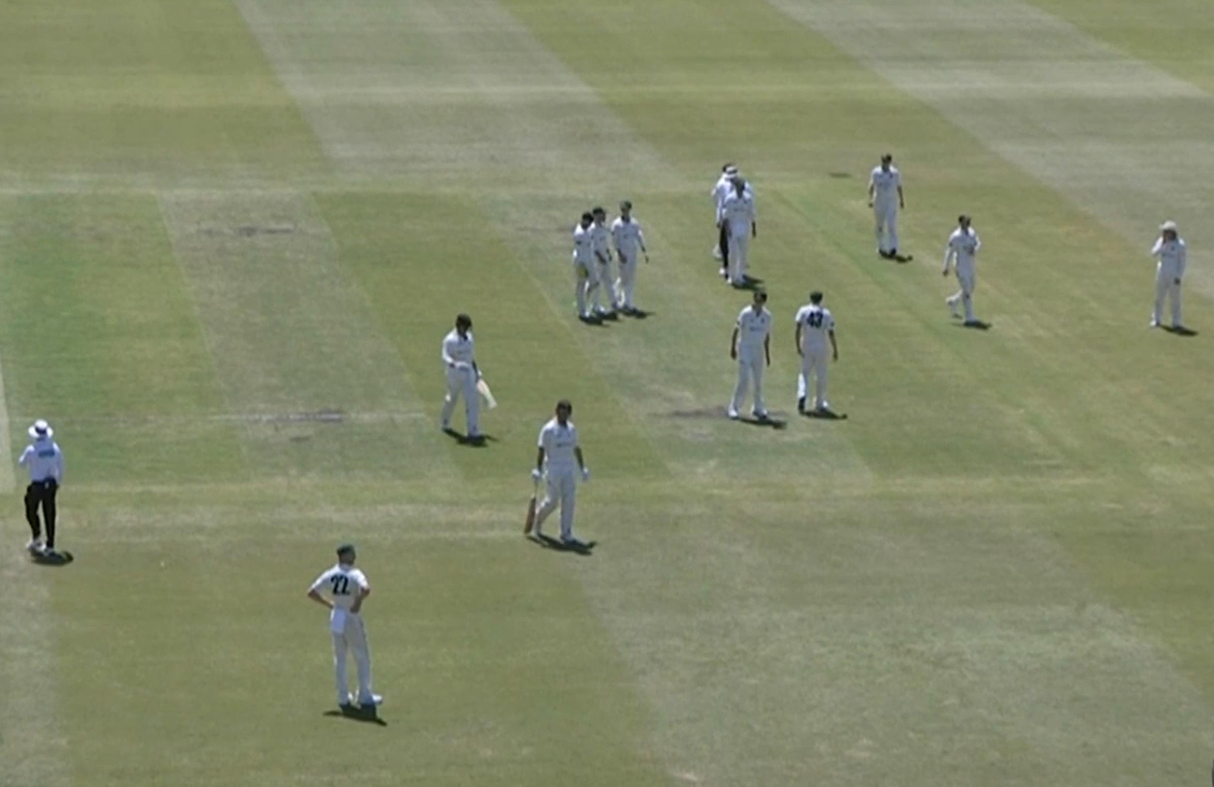 The players slowly walk from the ground