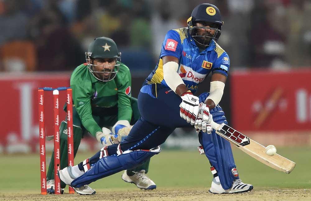 Bhanuka Rajapaksa on his way to 77 off 48 balls // AFP