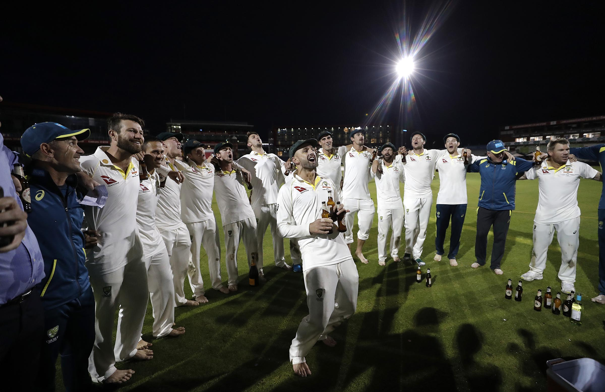 Lyon leads the team song after the Ashes were retained at Old Trafford // Getty