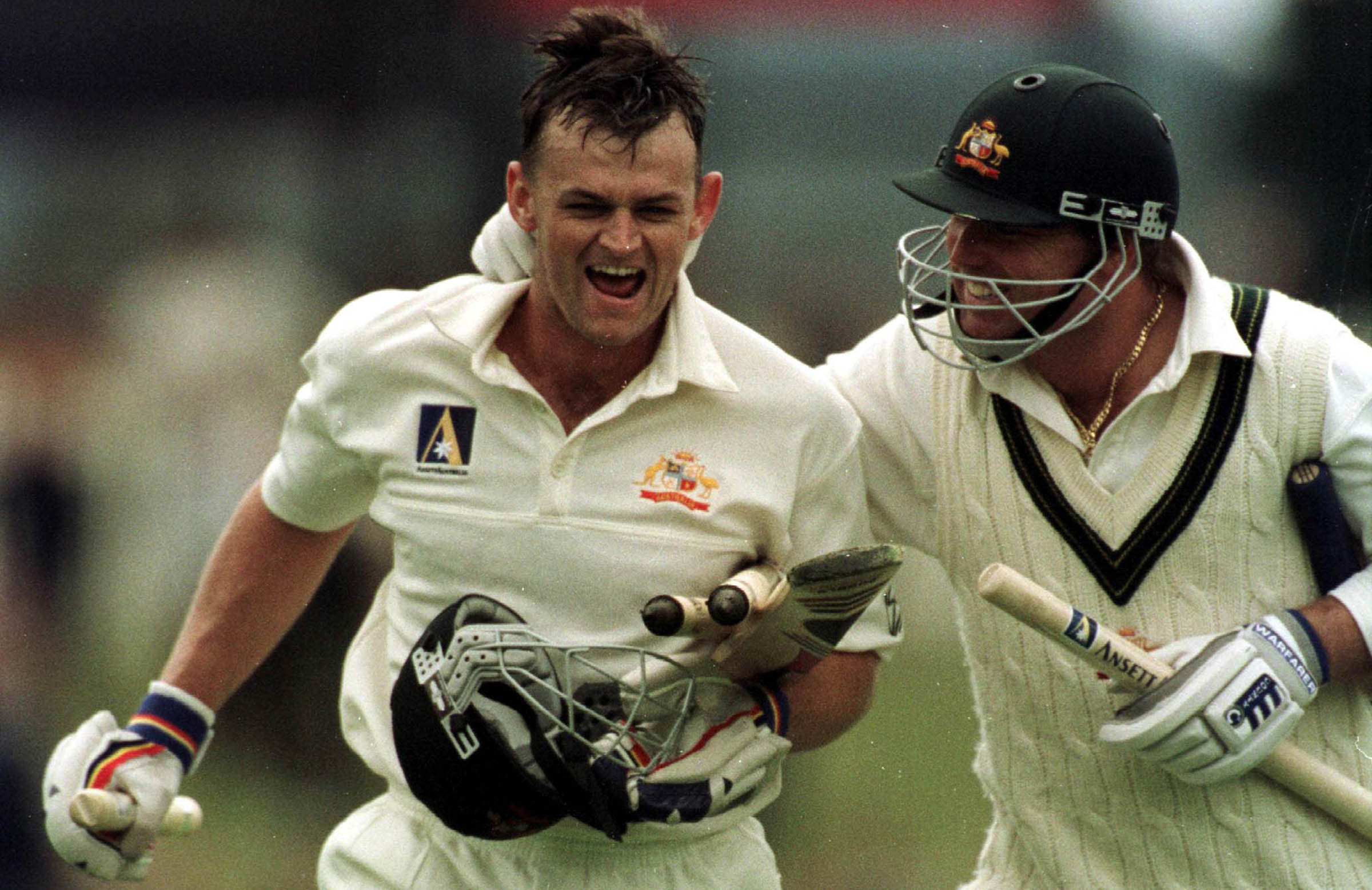 An ecstatic Gilchrist with Shane Warne after winning the 1999 Hobart Test // Getty