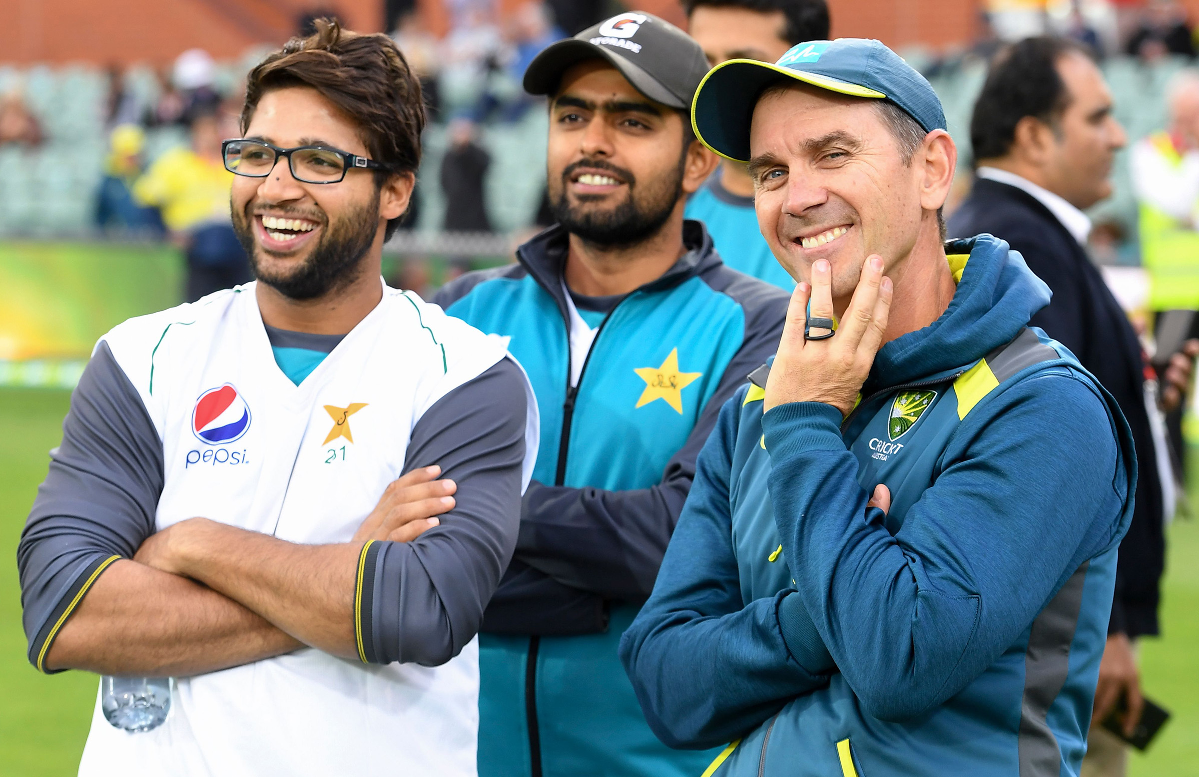 Imam-ul-Haq and Babar Azam share a laugh with Justin Langer // Getty