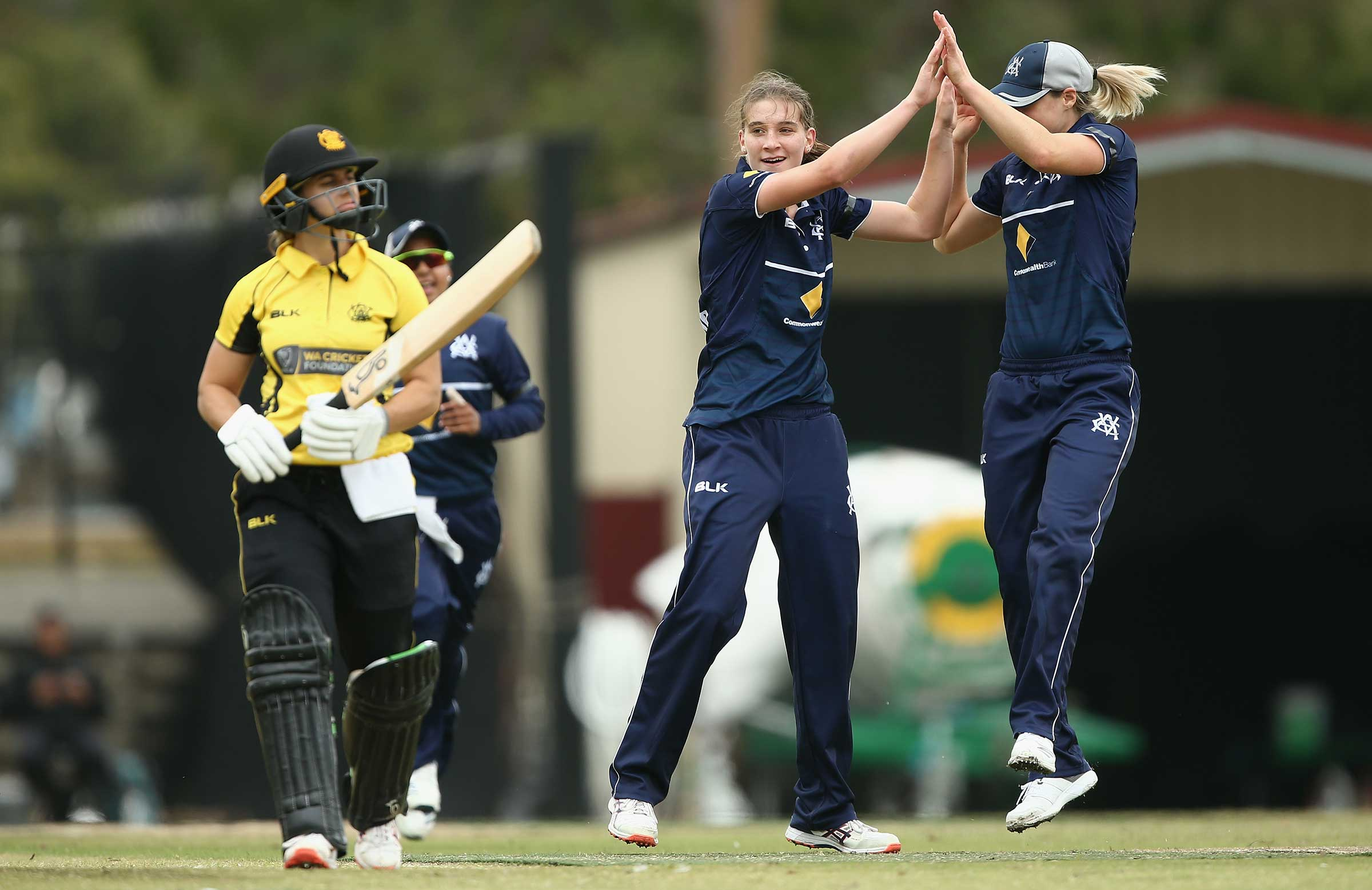 Sutherland celebrates a wicket with Perry // AAP