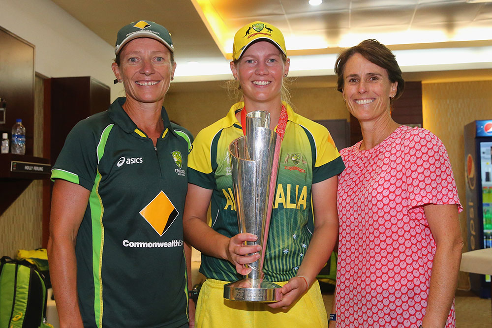 Fitzpatrick celebrates with captain Meg Lanning and the legendary Belinda Clark after coaching Australia to T20 World Cup success in 2014