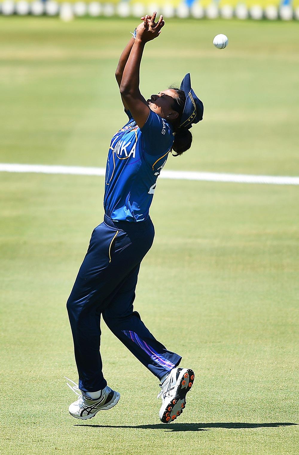 Achini Kulasuriya misjudges a catch attempt and is struck // ICC/Getty