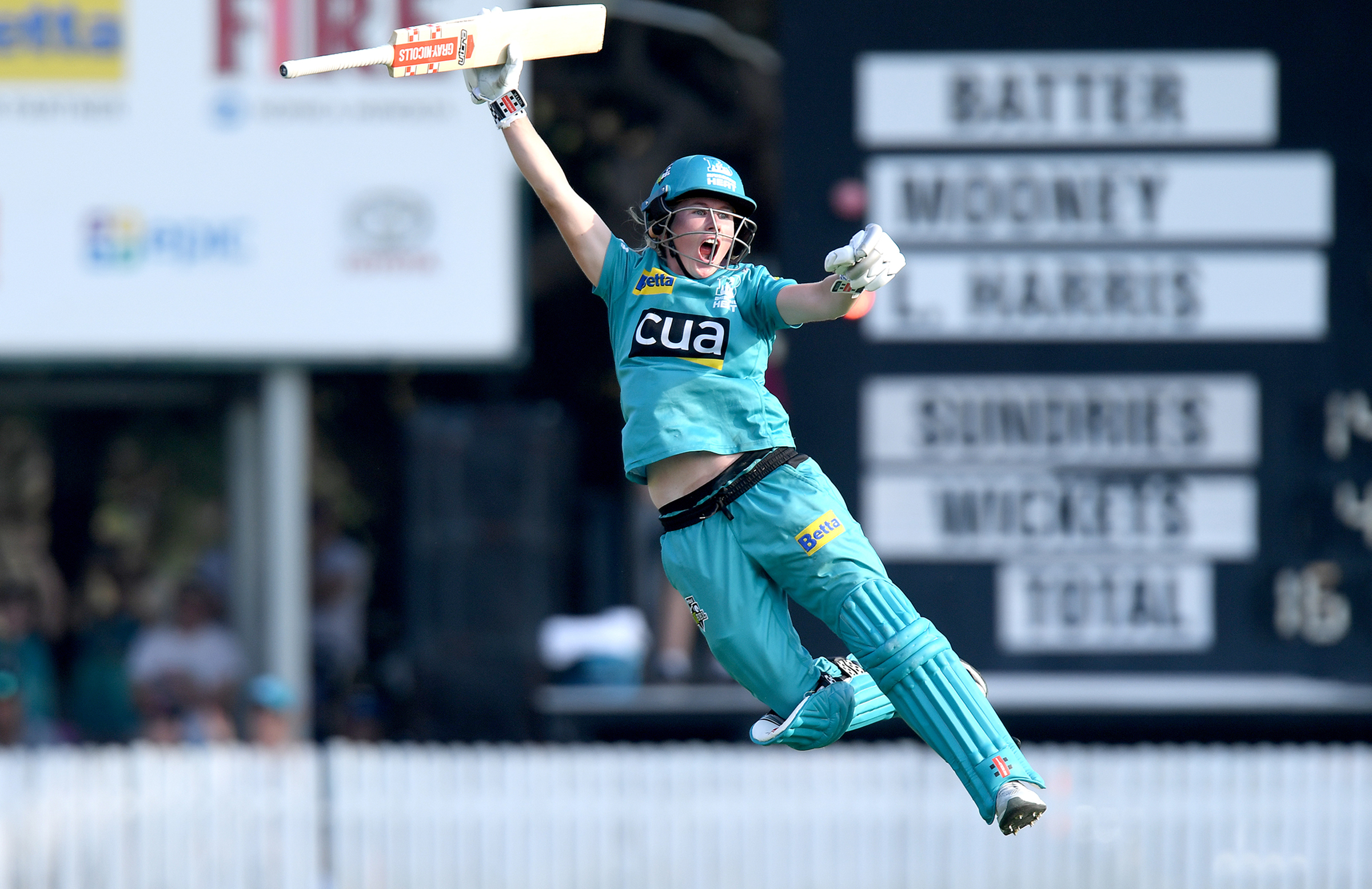 Mooney celebrates the Heat's win in the WBBL05 final // Getty