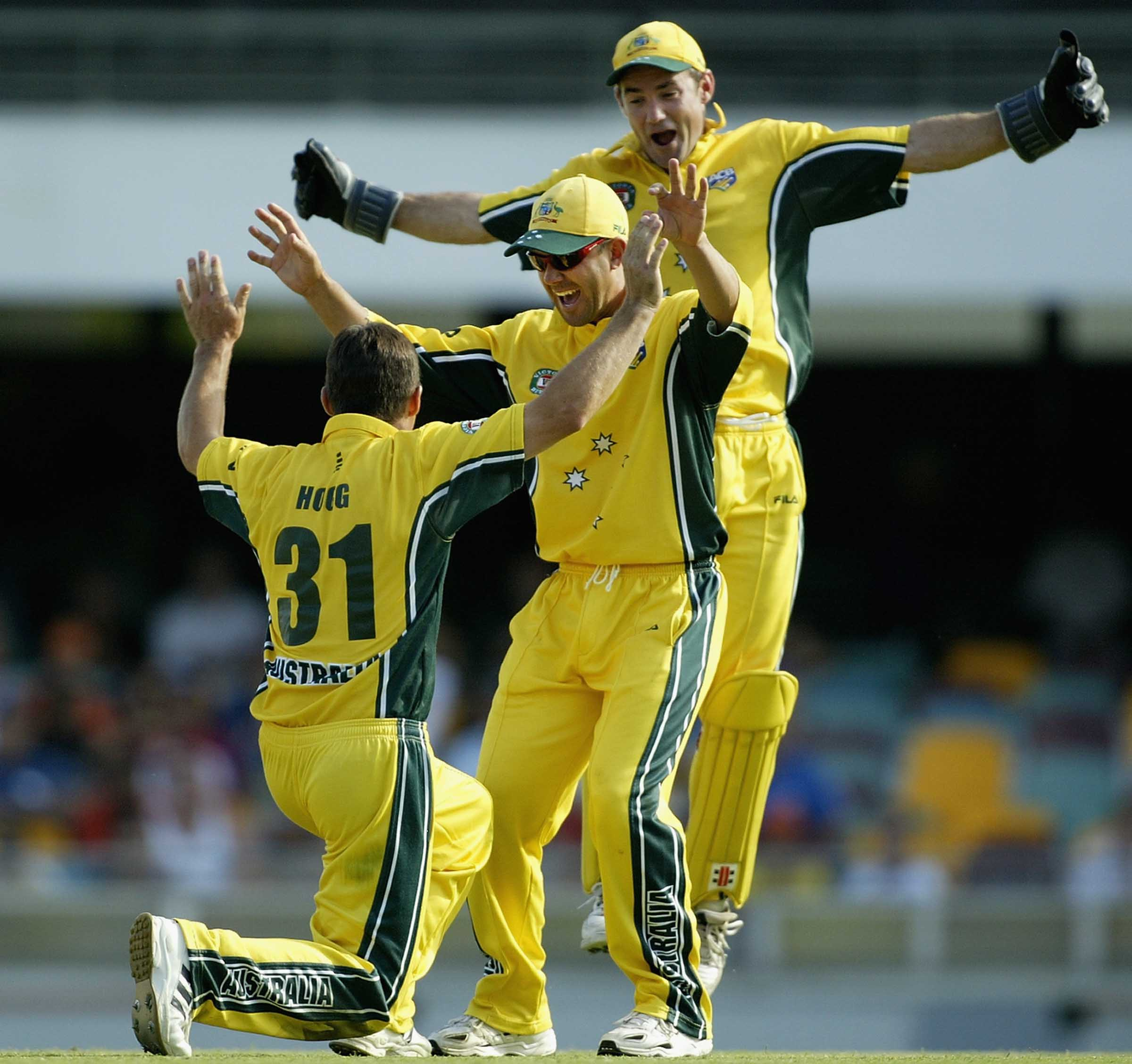Hogg celebrates a wicket with Ponting and stand-in 'keeper Maher // Getty