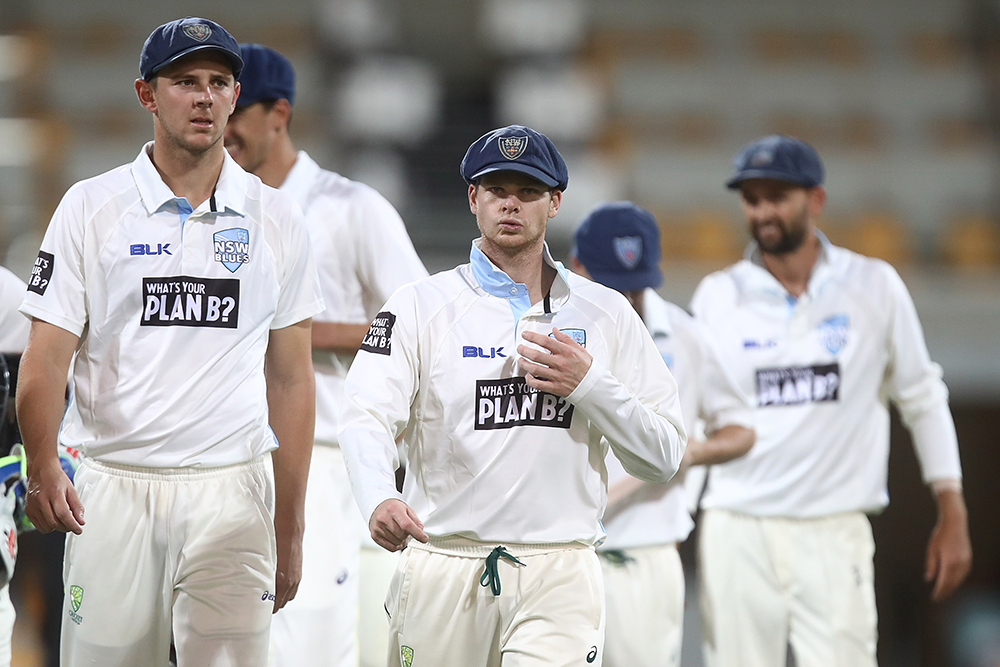 Josh Hazlewood and Steve Smith (with Mitchell Starc and Nathan Lyon in background) playing for New South Wales in 2016 // Getty