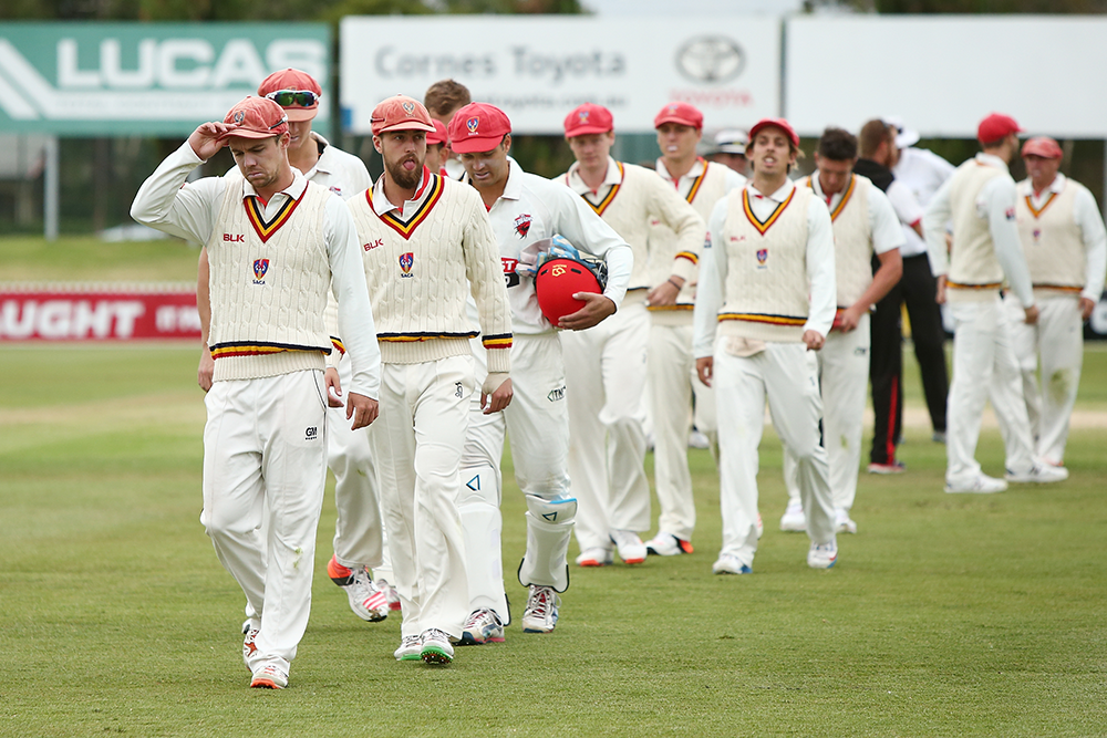 A dejected South Australian team leave the field after defeat to Victoria in the 2015-16 Sheffield Shield final // Getty