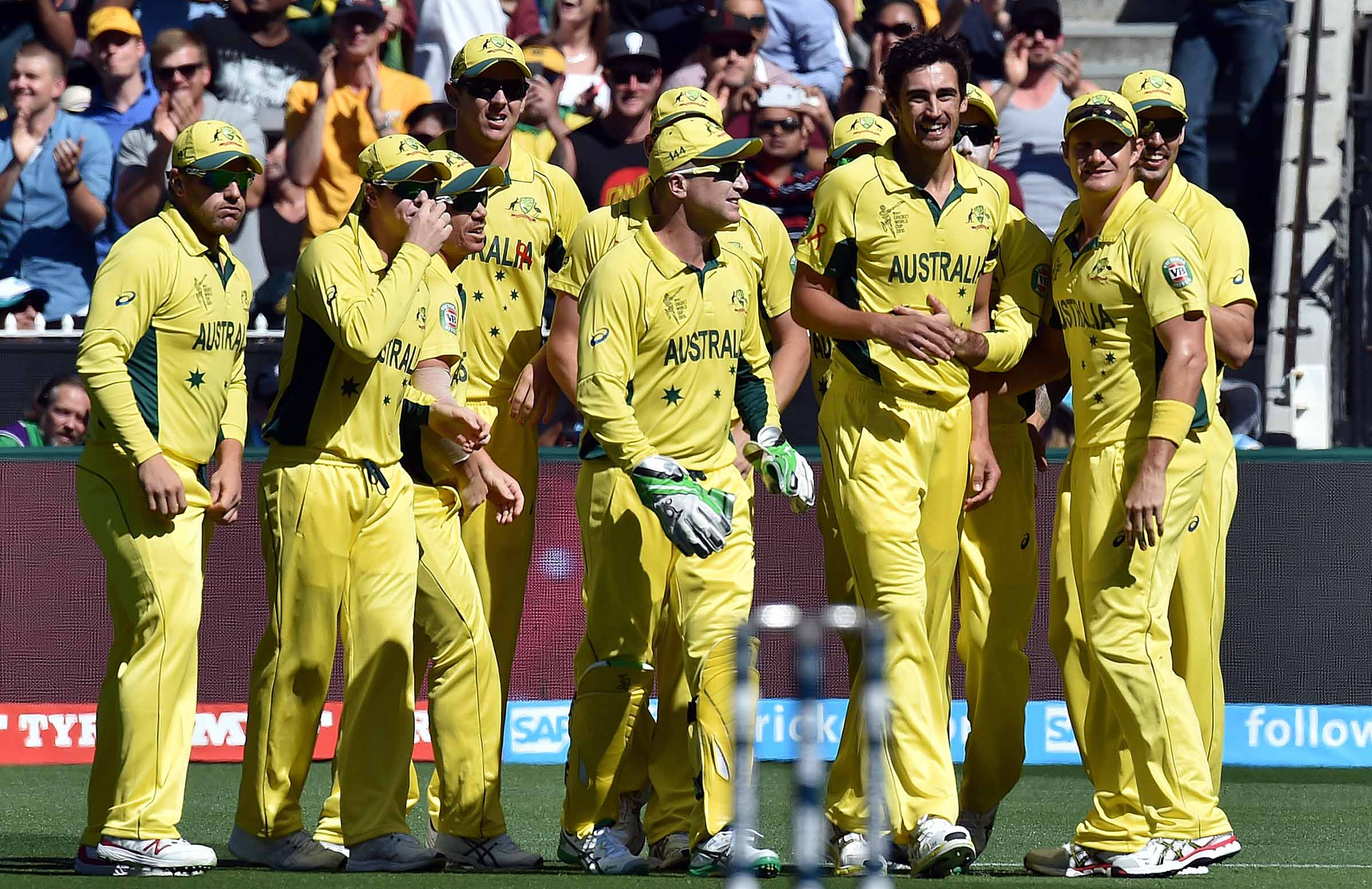 The Aussies celebrate a major early blow // Getty