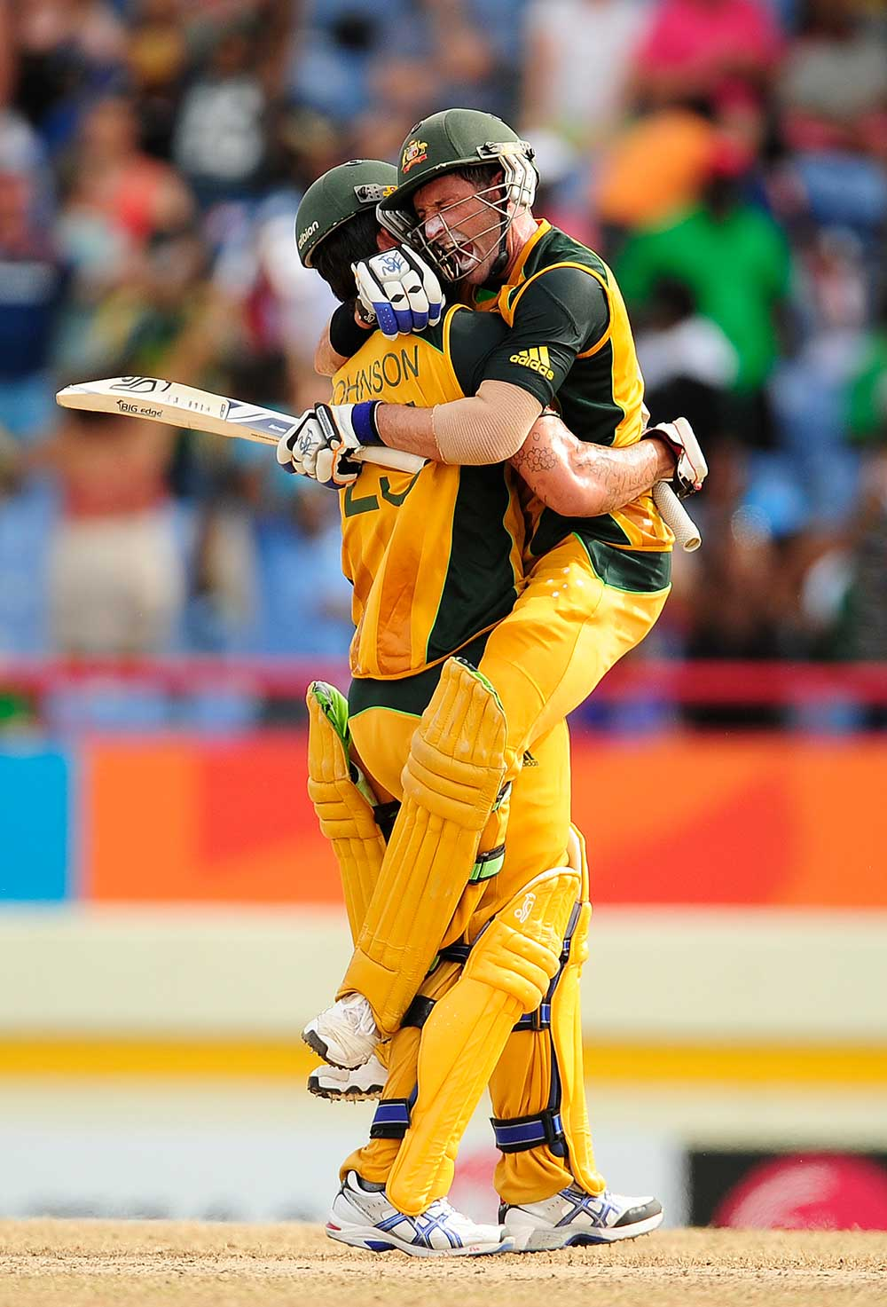 Mike Hussey celebrates the win with Mitch Johnson // Getty