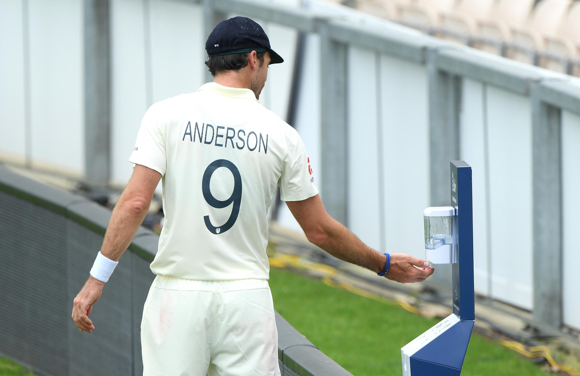 Jimmy Anderson makes use of a high-sanitising station // Getty
