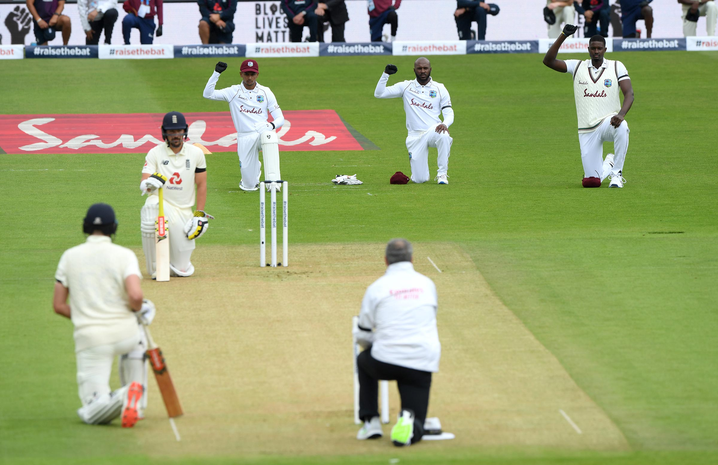 England's batters and the West Indies' fielders take a knee ahead of the first Test in Southampton // Getty