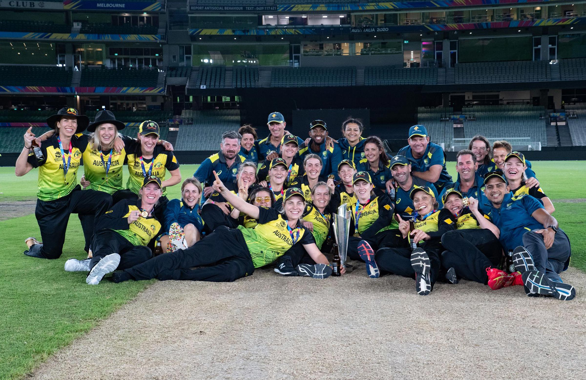 The Australian players and staff celebrate in the middle of the MCG in March // Nick Price, cricket.com.au