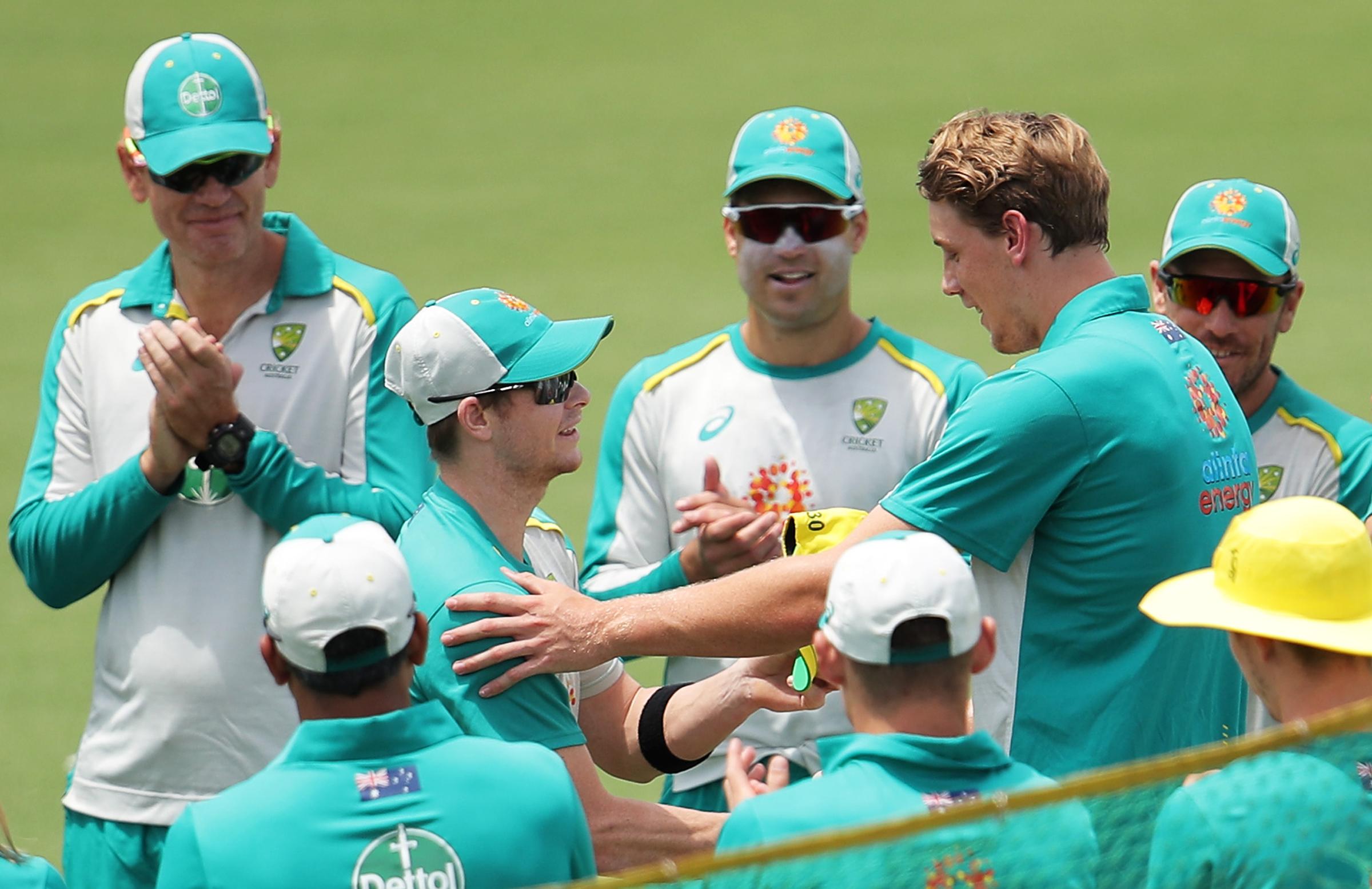 Smith presents Green with men's ODI cap No.230 // Getty