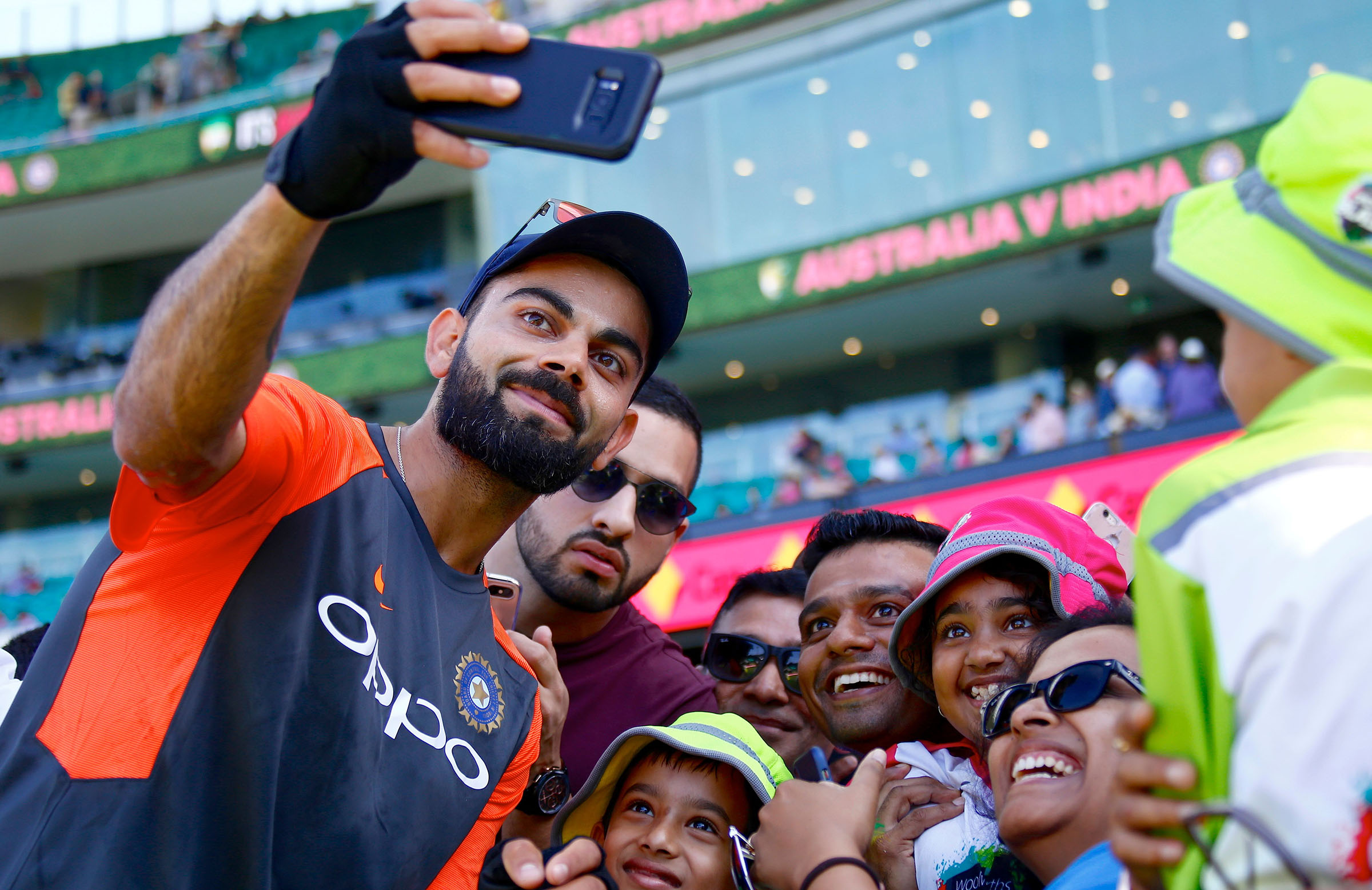 Virat Kohli with some of his fans // Getty