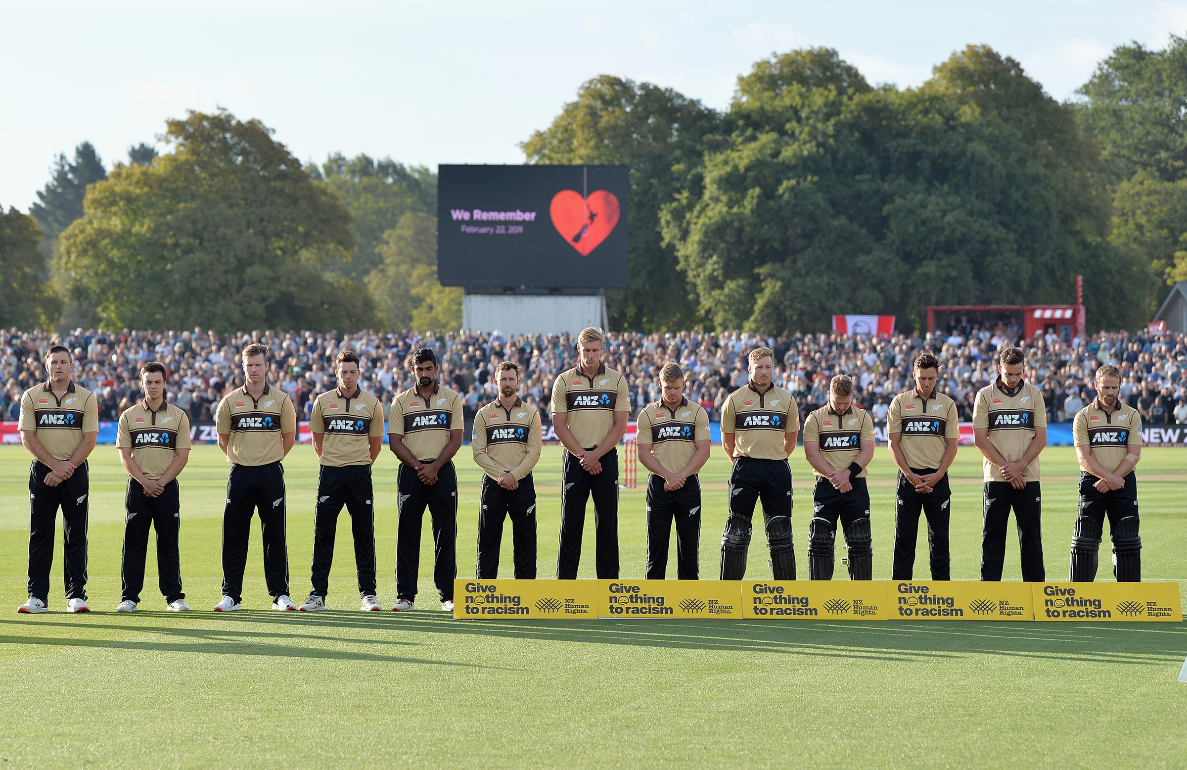 Players observe a moment of silence before play // Getty