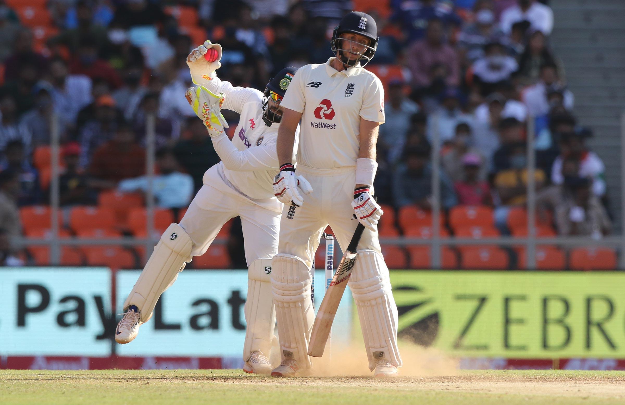 Joe Root takes action as Rishabh Pant takes the ball above his head // BCCI-Sportzpics