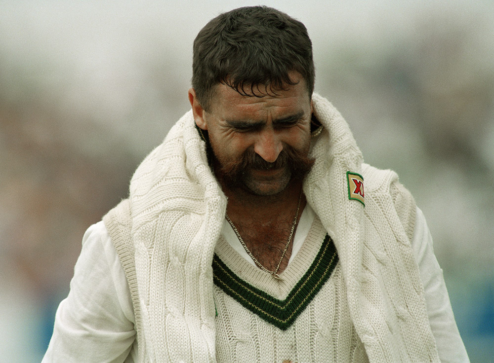 Hughes grimaces after a spell in the '93 Ashes // Getty