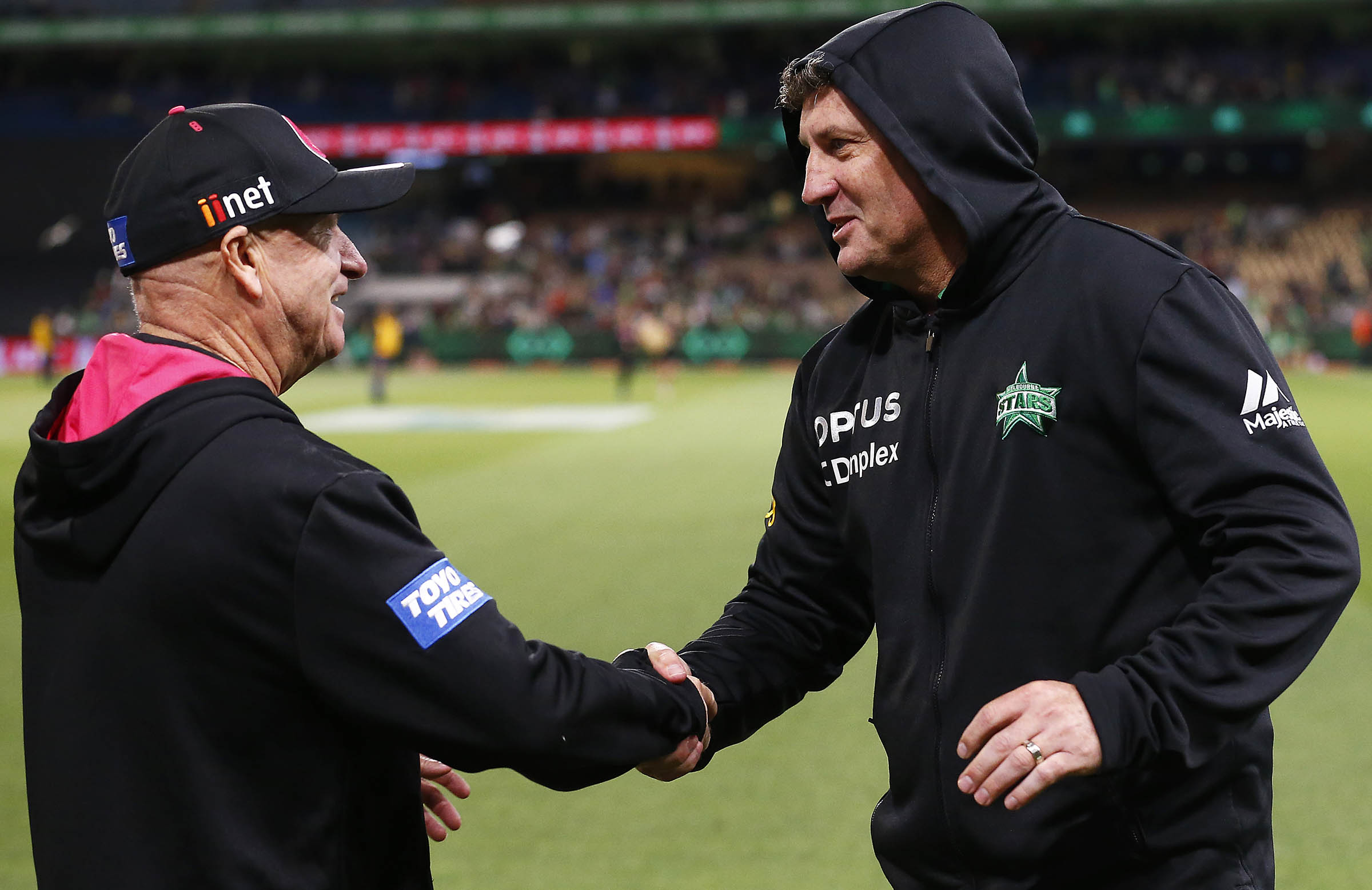 With former charge and now coaching rival David Hussey // Getty