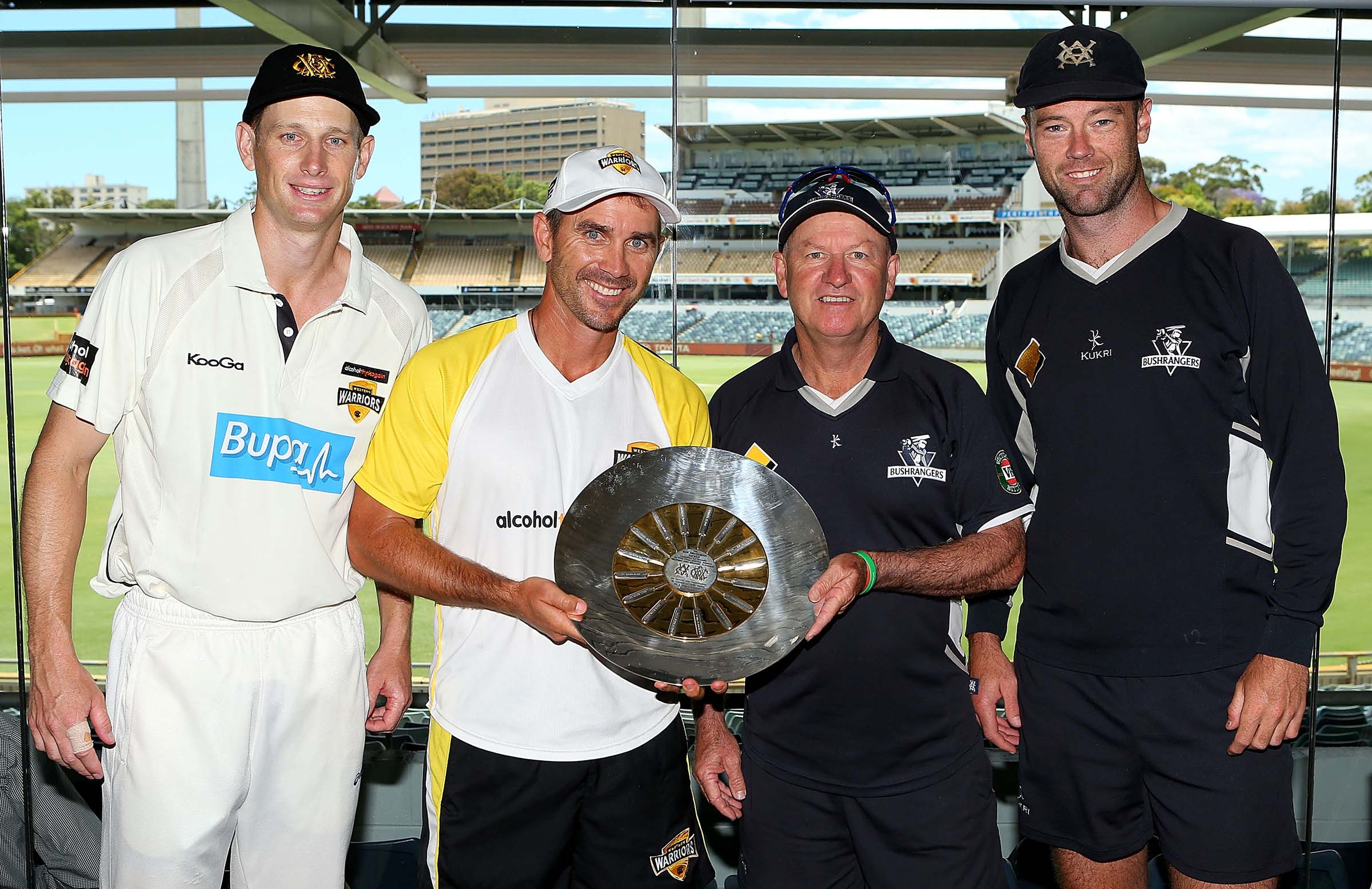 Holding the Sheffield Shield trophy with his former Scarborough teammate Justin Langer // Getty