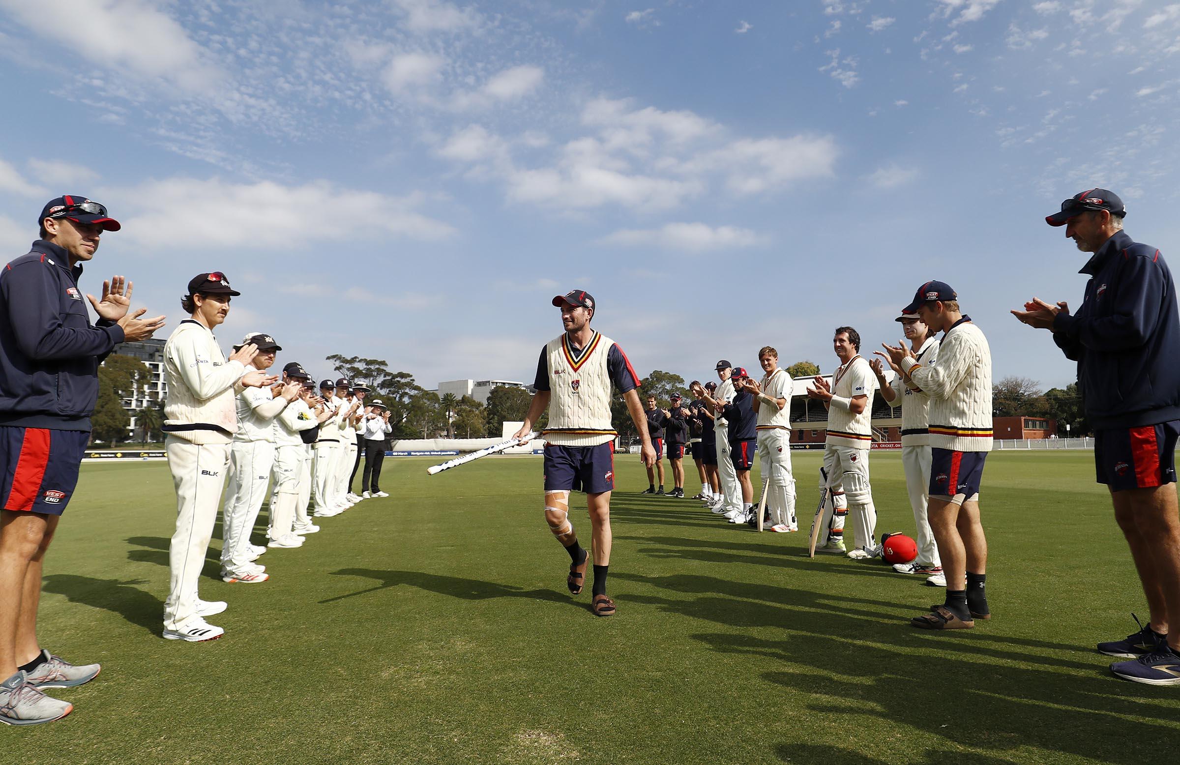 Retiring SA paceman Chadd Sayers walks through a guard of honour // Getty