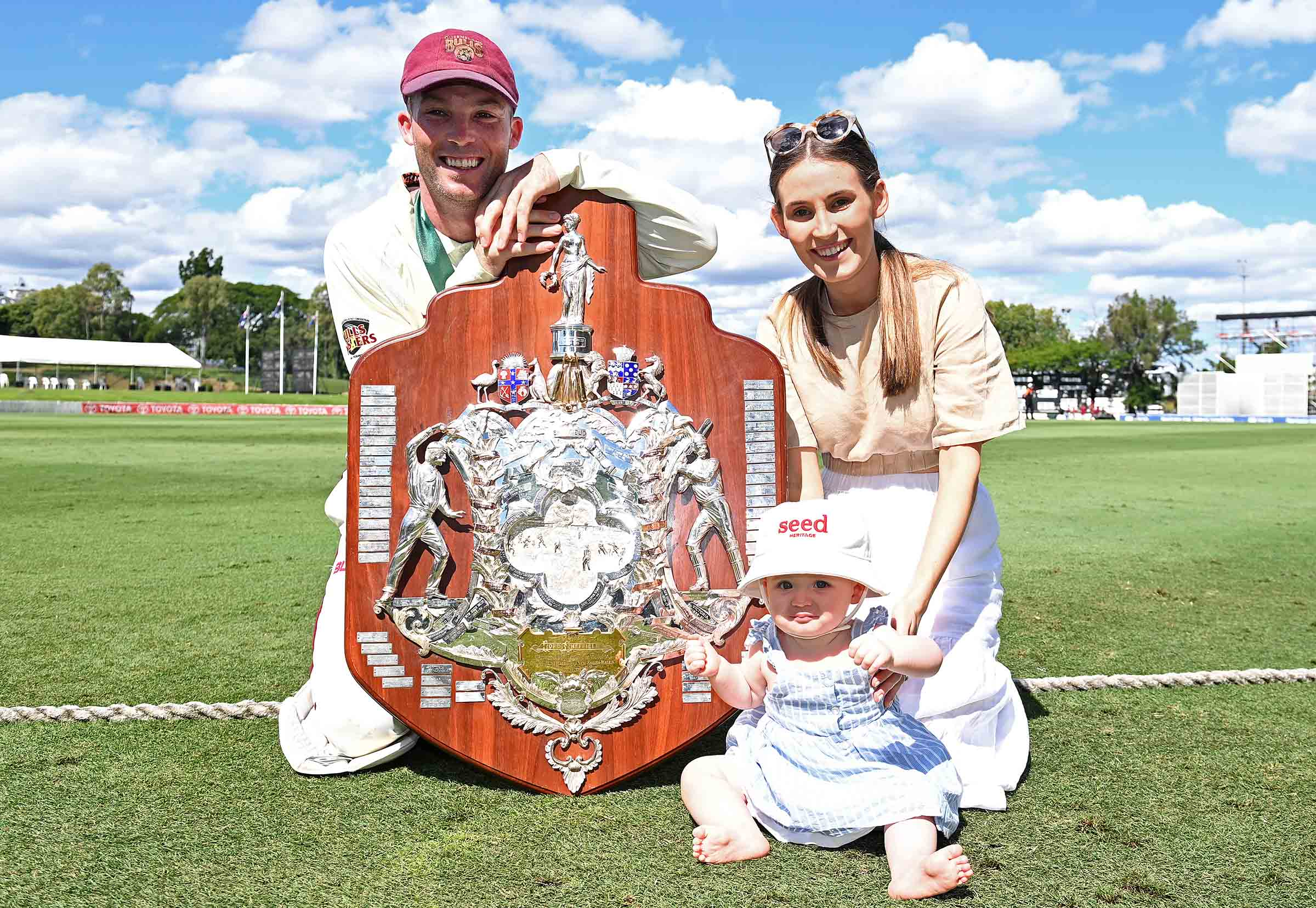 With wife Amy, daughter Evie and the Sheffield Shield trophy // Getty