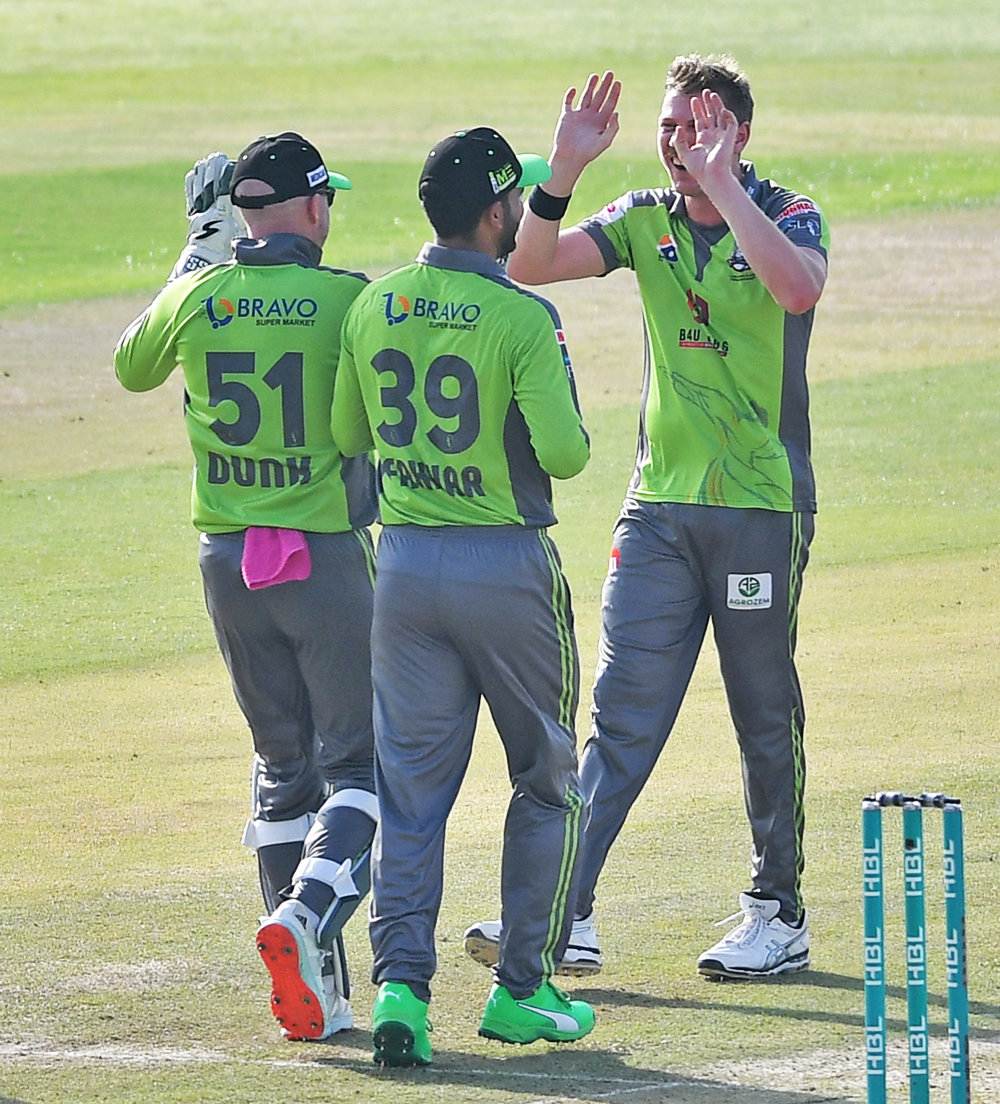 James Faulkner celebrates one of his three wickets // PCB