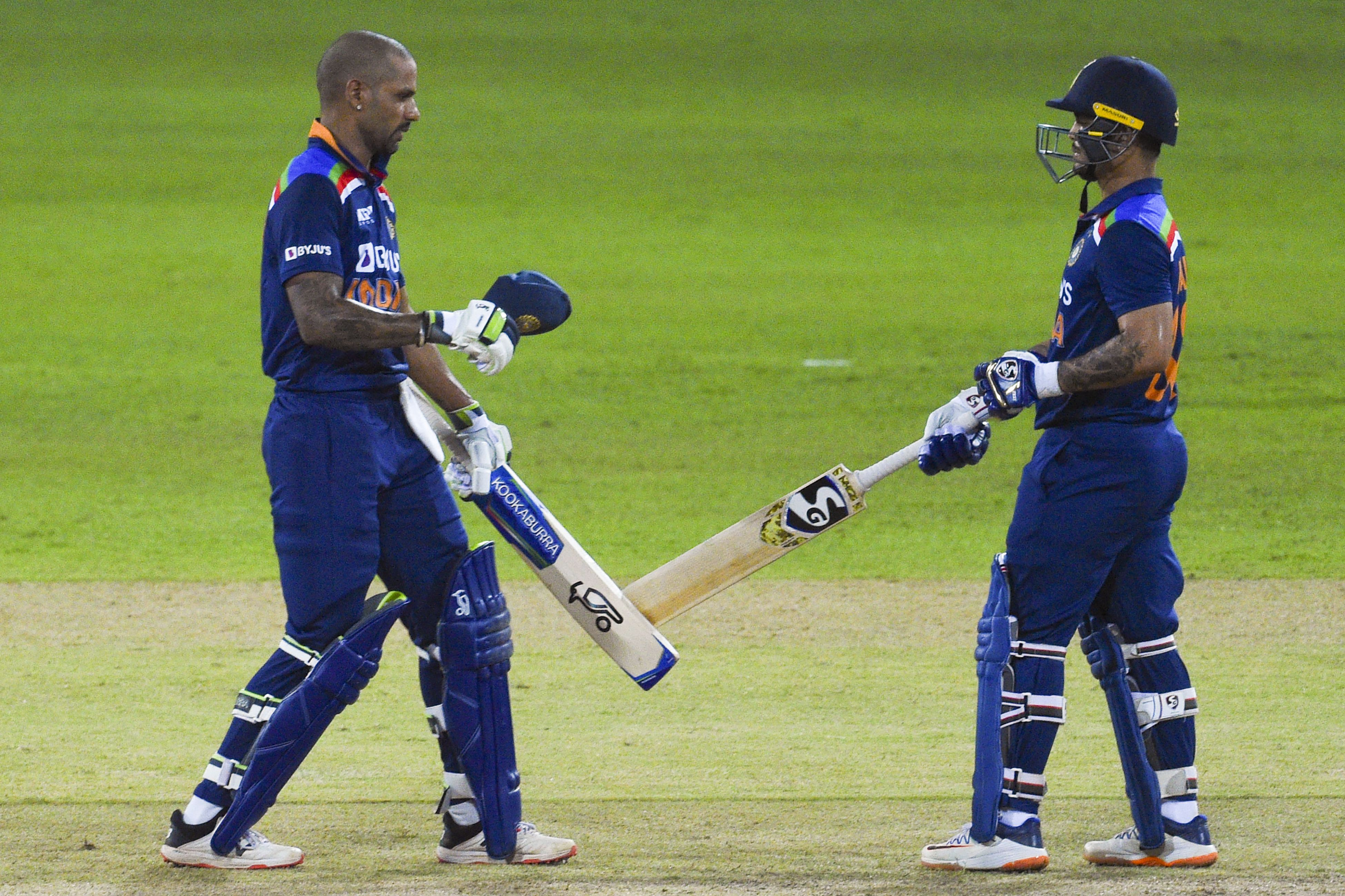 Shikhar Dhawan (left) and Ishan Kishan shared an 85-run stand off only 74 balls // Getty