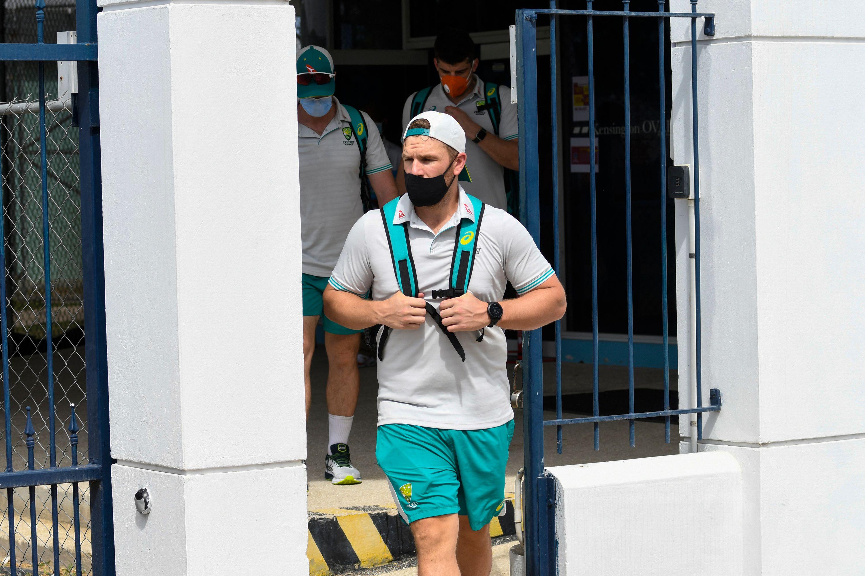 Injured Australia captain Aaron Finch leaves Kensington Oval // Getty