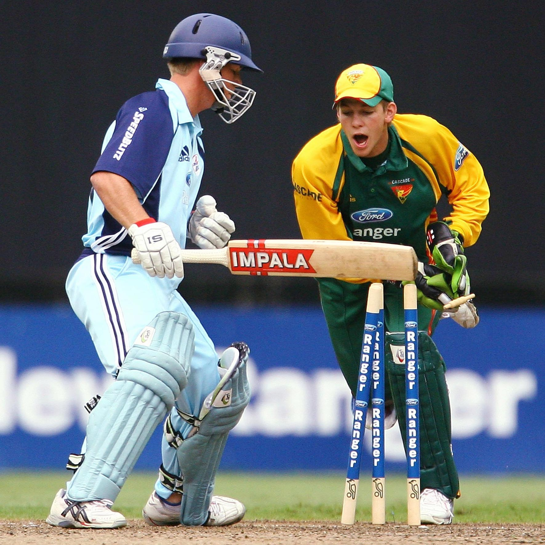 A young Tim Paine stumps a young David Warner // Getty