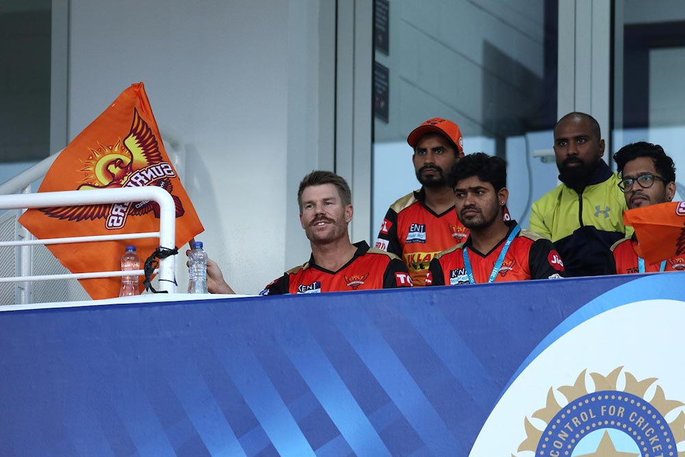 Warner was relegated to cheerleader in the stands // Sportzpics/BCCI